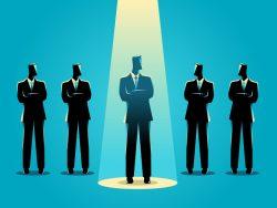 Un dessin de cinq hommes d'affaires les uns à côté des autres. Un est un peu en avant avec une lumière sur lui.