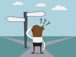 Un petit personnage devant deux chemins avec des panneaux. Il hésite sur la route à prendre