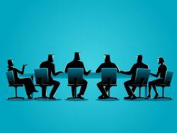 Plusieurs personnages assis autour d'une grande table.