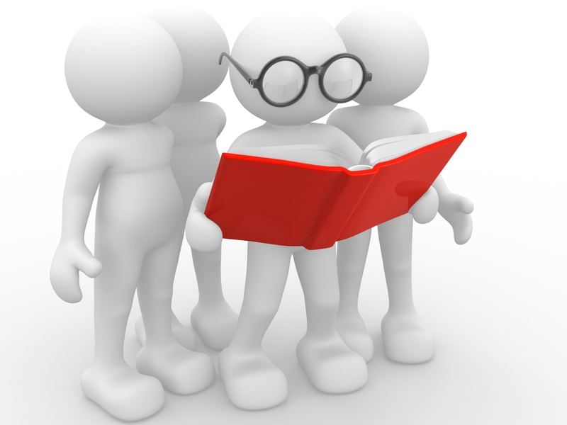 Plusieurs bonhomme regardant par dessus l'épaule d'un dernier qui lit un document dans un grand livre rouge.