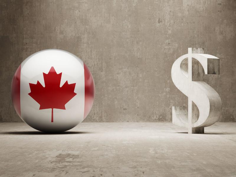 une petite boule sur lequel on retrouve le drapeau du Canada à côté d'un signe de dollar