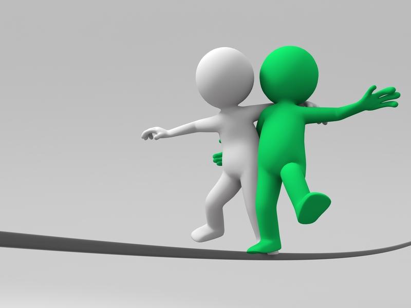 Deux personnages en équilibre sur un fil, qui se tiennent par les épaules.