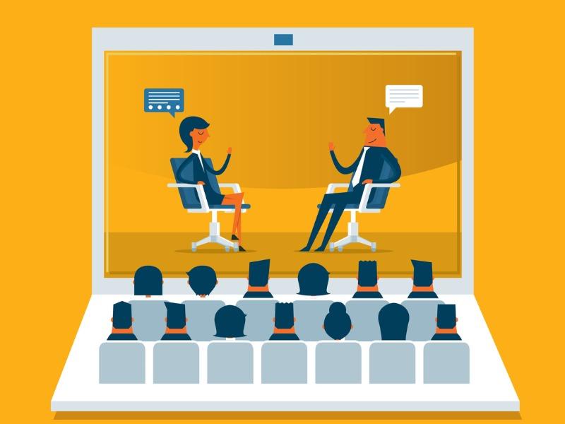 On voit dans un écran d'ordinateur, une femme et un homme assis qui se parle. Devant, à la place des touches de clavier, on voit pleins d'auditeurs.