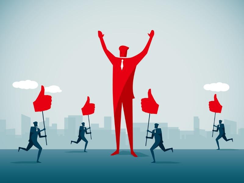 Un homme d'affaire géant rouge est au milieu de l'image. Pleins d'autres hommes d'affaires en bleu portant des pouces en l'air courent vers lui.